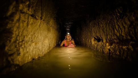 Woman Surfs the Underground Paris Catacombs!